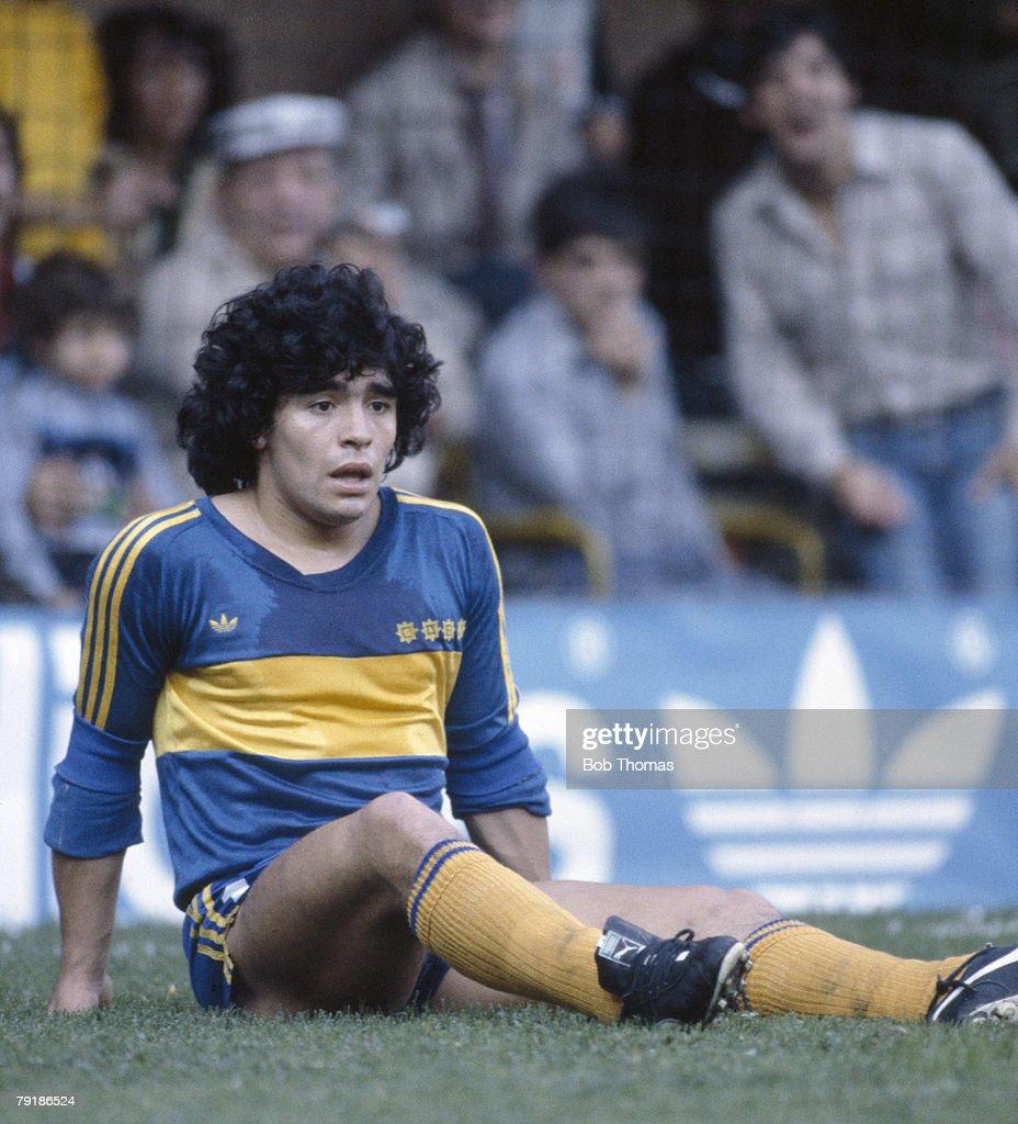 Boca Junior's striker Diego Maradona sits on the ground ...