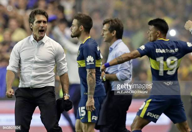 Boca Junior's team coach Guillermo Barros Schelotto celebrates after his team defeated Talleres by 21 during their Argentina First Division Superliga...