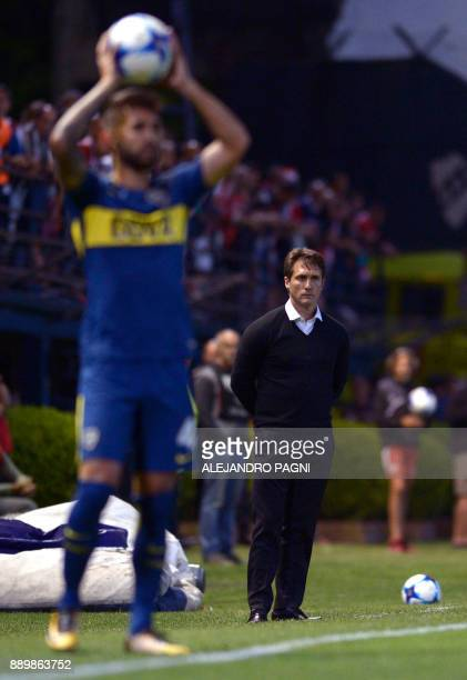 Boca Juniors' team coach Guillermo Barros Schelotto follows the action from the sideline during their Argentina First Division Superliga football...