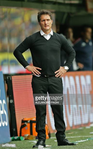 Boca Junior's team coach Guillermo Barros Schelotto gestures during the Argentina First Division Superliga football match against Talleres at La...