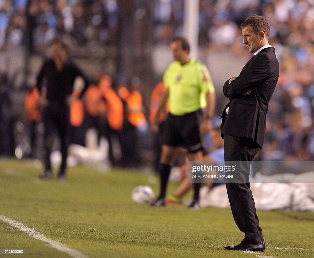 Boca Juniors team coach Rodolfo Arruabarrena gestures during their Argentina First Division football match against Racing Club at Presidente Peron stadium in Avellaneda, Buenos Aires, on February 28, 2016.