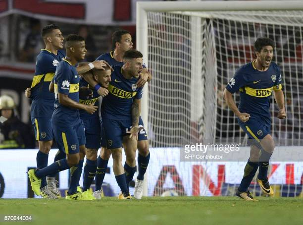 Boca Juniors' Uruguayan midfielder Nahitan Nandez celebrates with teammates after scoring against River Plate during the Argentine derby match in the...