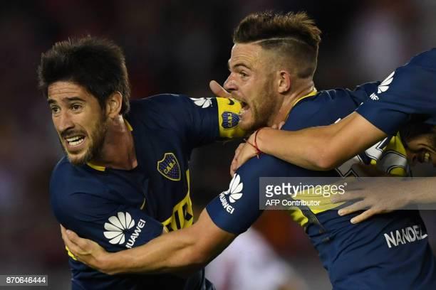 Boca Juniors' Uruguayan midfielder Nahitan Nandez celebrates with teammate midfielder Pablo Perez during the Argentine derby match against River...