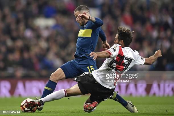 TOPSHOT Boca Juniors' Uruguayan Nahitan Nandez is challenged by River Plate's Leonardo Ponzio during the second leg match of their allArgentine Copa...