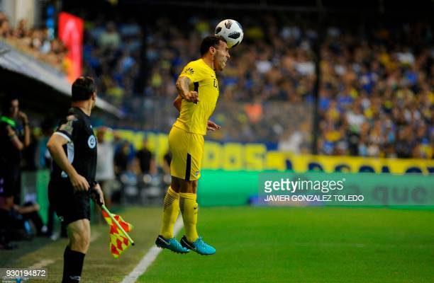 TOPSHOT Boca Juniors's forward Carlos Tevez controls the ball with head during the Argentina First Division Superliga football match against Tigre at...