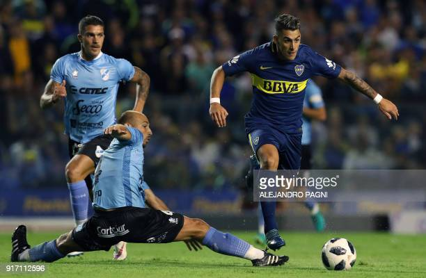Boca Juniors's forward Cristian Pavon runs with the ball past Temperley's defender Adrian Scifo during their Argentina First Division Superliga...