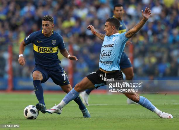 Boca Juniors's forward Cristian Pavon vies for the ball with Temperley's midfielder Adrian Arregui during their Argentina First Division Superliga...