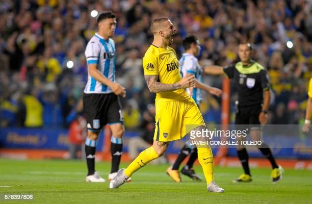 Boca Juniros' forward Dario Benedetto celebrates after scoring against Racing Club during the Argentina's Superliga first division match at La...