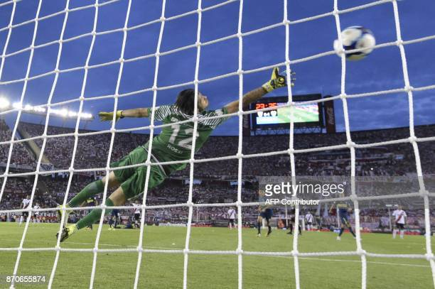Boca Junirs' goalkeeper Agustin Rossi cant stop a River Plate's midfielder Leonardo Ponzio goal during the Argentine derby match in the Superliga...