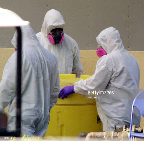 Boca Raton Fire Rescue personnel move a barrel to throw away contaminated waste at the American Media Inc building after a suspected anthrax attack...