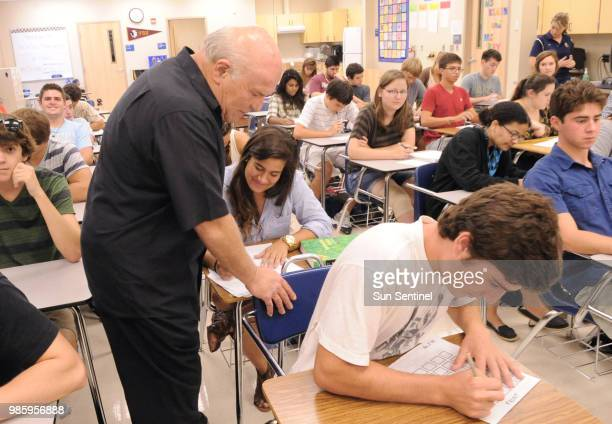 Boca Raton High School teacher Richard Goldsmith answers a question for Marcela Thomas during a quiz in her AP European History class in September...