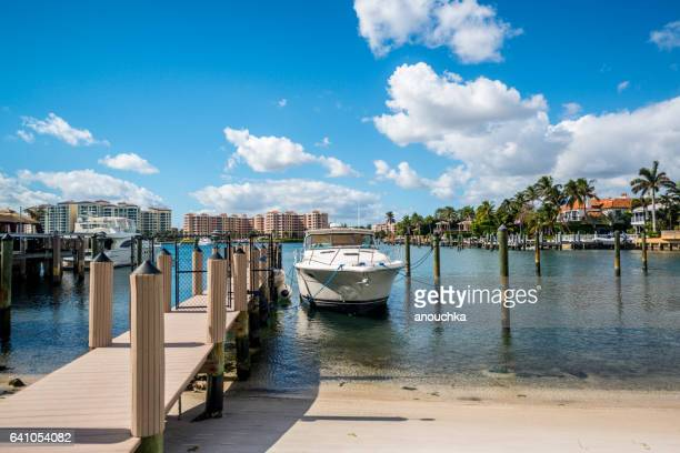 Boca Raton marina with yacht and residential buildings, USA