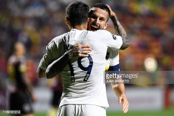Boca's Dario Benedetto celebrates with teammate Mauro Zarate after scoring a goal during the 2019 Copa Libertadores football match between...