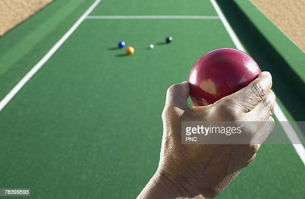 Bocce player holding a ball