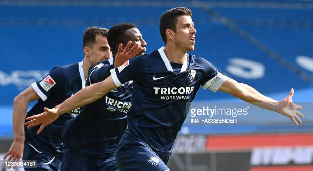 Bochum's French midfielder Anthony Losilla celebrates scoring the 2-1 goal with teammates during the German second division Bundesliga football match...