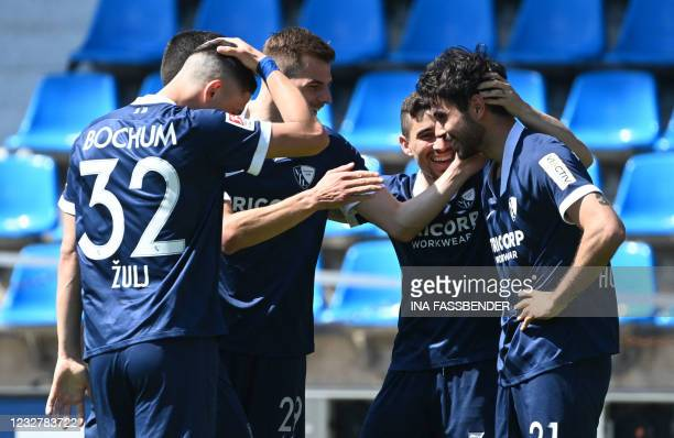 Bochum's German forward Gerrit Holtmann celebrates with teammates after scoring the 3-1 during the German second division Bundesliga football match...