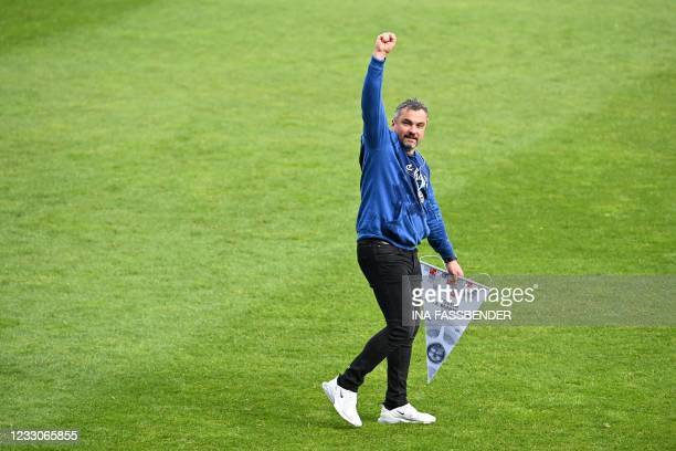 Bochum's German head coach Thomas Reis celebrates after the club won the Bundesliga second division championship after a 3-1 during the German second...