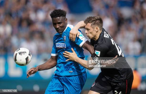 Bochum's Peniel Mlapa and St Pauli's Sören Gonther vie for the ball during the German Bundesliga 2nd league soccer match between VfL Bochum and FC St...