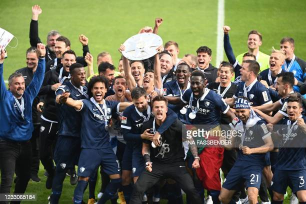 Bochum's players celebrate with the trophy of the Bundesliga second division championship after the club won 3-1 during the German second division...