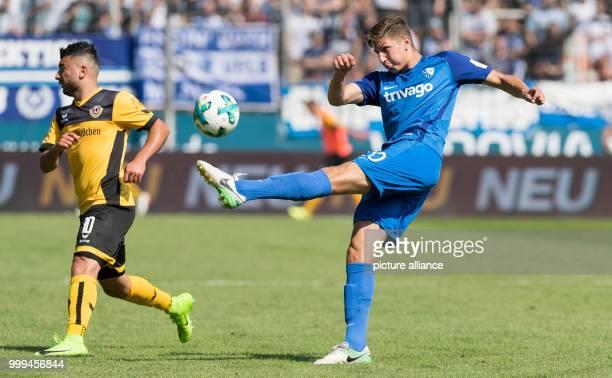 Bochum's Vitaly Janelt and Dresden's Aias Aosman vying for the ball during the 2nd Bundesliga match pitting VfL Bochum vs Dynamo Dresden in Bochum...