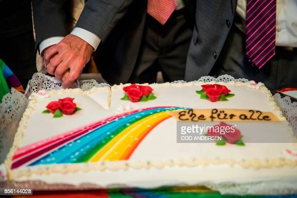 Bode Mende and Karl Kreile cut the rainbow wedding cake during the wedding ceremony as they are became Germany's first gay couple to be legally...