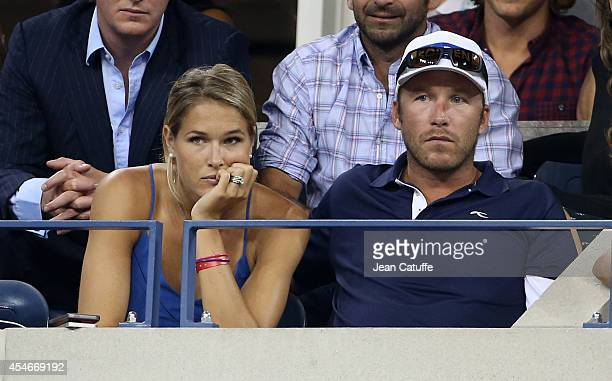 Bode Miller and his wife Morgan Beck Miller attend the match between Roger Federer of Switzerland and Gael Monfils of France during Day 11 of the...