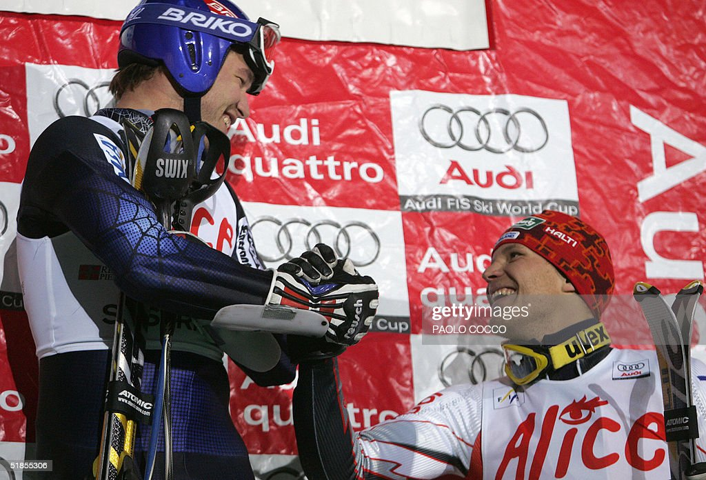 Bode Miller (L) is congratulated by Finnish Kalle Palander after winning the World Cup men's slalom competition in Sestriere 13 December 2004. Switzerland's Silvan Zurbriggen took the second place while Kalle Palander finished third. AFP PHOTO/Paolo COCCO