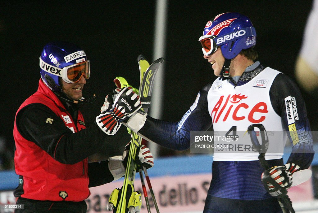 US Bode Miller (R) is congratulated by Switzerland's Silvan Zurbriggen after winning the World Cup men's slalom competition in Sestriere 13 December 2004. Silvan Zurbriggen took the second place while Finnish Kalle Palander finished third. AFP PHOTO/Paolo COCCO