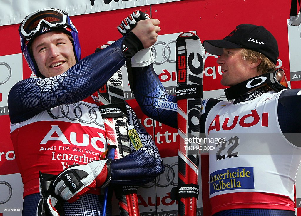 US Bode Miller (L) jubilates with US Daron Rahlves on the podium after the men's Ski World Cup final super-G race in Lenzerheide, 11 March 2005. Miller won the race and the globe ex-aeqo with his teammate Daron Rahlves, Austria's Stephan Goergl ranked second and Lichtenstein's Marco Buechel ranked third.