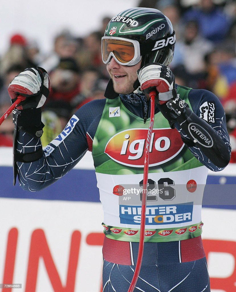 Bode Miller of the United States celebrates in the finish area after taking winning the men's super-G World Cup race in Hinterstoder 20 December 2006. Miller won ahead of Italian Peter Fill and Austrian Hermann Maier.