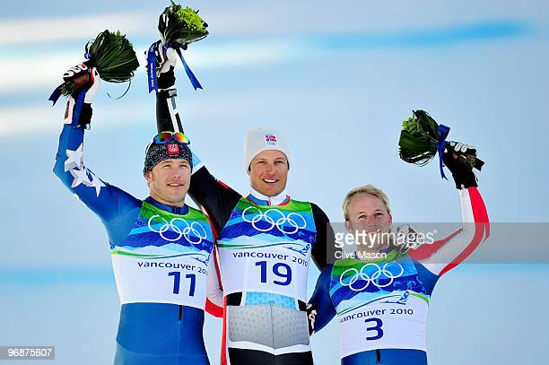 Bode Miller of the United States celebrates winning silver Aksel Lund Svindal of Norway gold and Andrew Weibrecht of the United States bronze during...