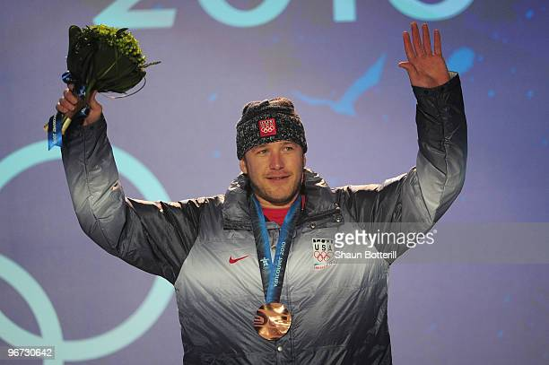 Bode Miller of the United States celebrates with the bronze at the medal ceremony for the Alpine skiing Men's Downhill at Whistler Medal Plaza during...