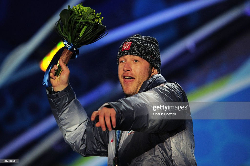 Bode Miller of the United States celebrates with the bronze at the medal ceremony for the Alpine skiing Men's Downhill at Whistler Medal Plaza during the Vancouver 2010 Winter Olympics on February 15, 2010 in Whistler, Canada.