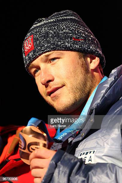 Bode Miller of the United States poses with the bronze at the medal ceremony for the Alpine skiing Men's Downhill at Whistler Medal Plaza during the...