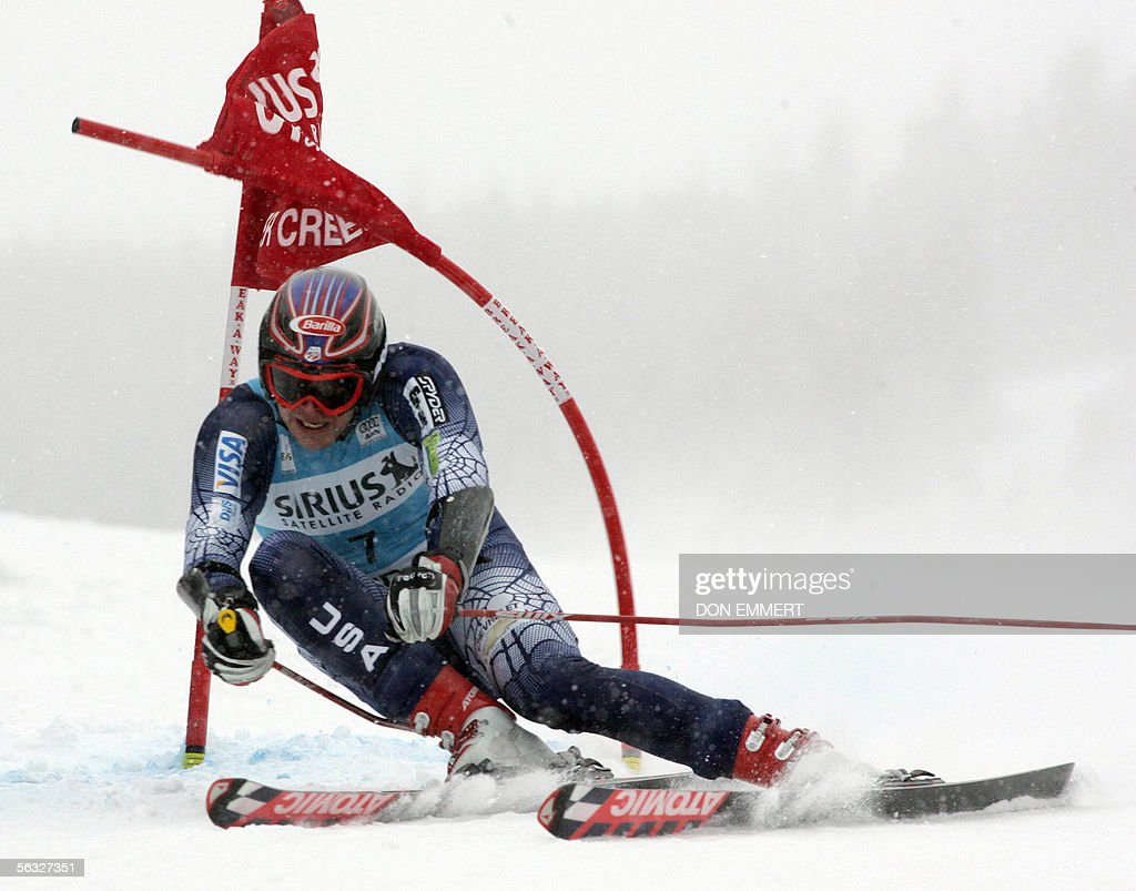 Bode Miller of the US hits a gate during the first run of the World Cup men's Giant Slalom 03 December, 2005, on the Birds of Prey course in Beaver Creek, Colorado. Miller had the best time in the first run with 1:16.14.
