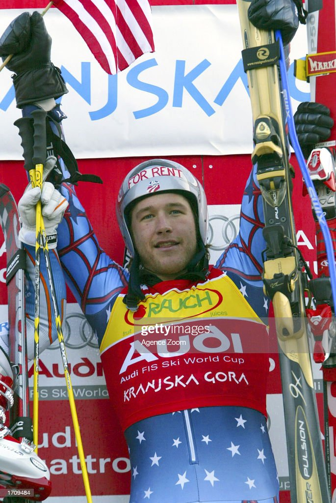 Bode Miller of the USA celebrates at the podium after winning the Men's Giant Slalom on January 4, 2003 at the FIS World Cup in Kranjska Gora, Slovenia.