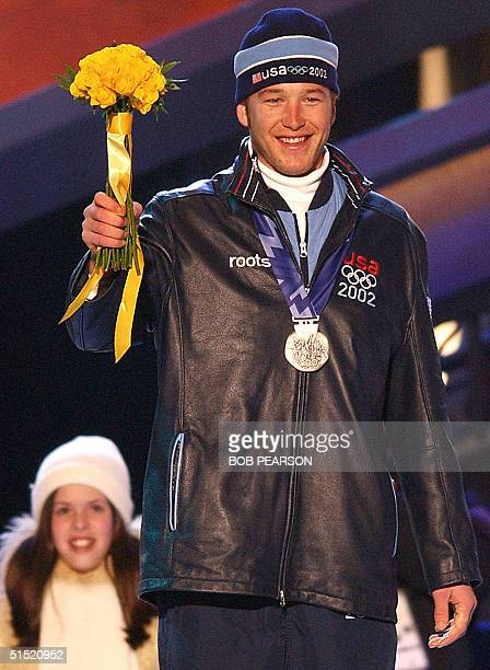 Bode Miller of the USA celebrates his silver medal in the Men's Giant Slalom during ceremonies at the XIX Winter Olympics 21 February 2002 in Salt...