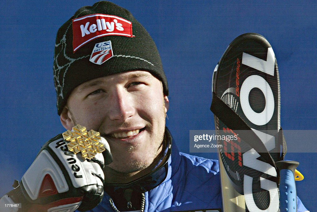 Bode Miller of the USA celebrates with his Gold Medal in the Men's Giant Slalom during the FIS World Ski Championships on February 12, 2003 in St. Moritz, Switzerland.