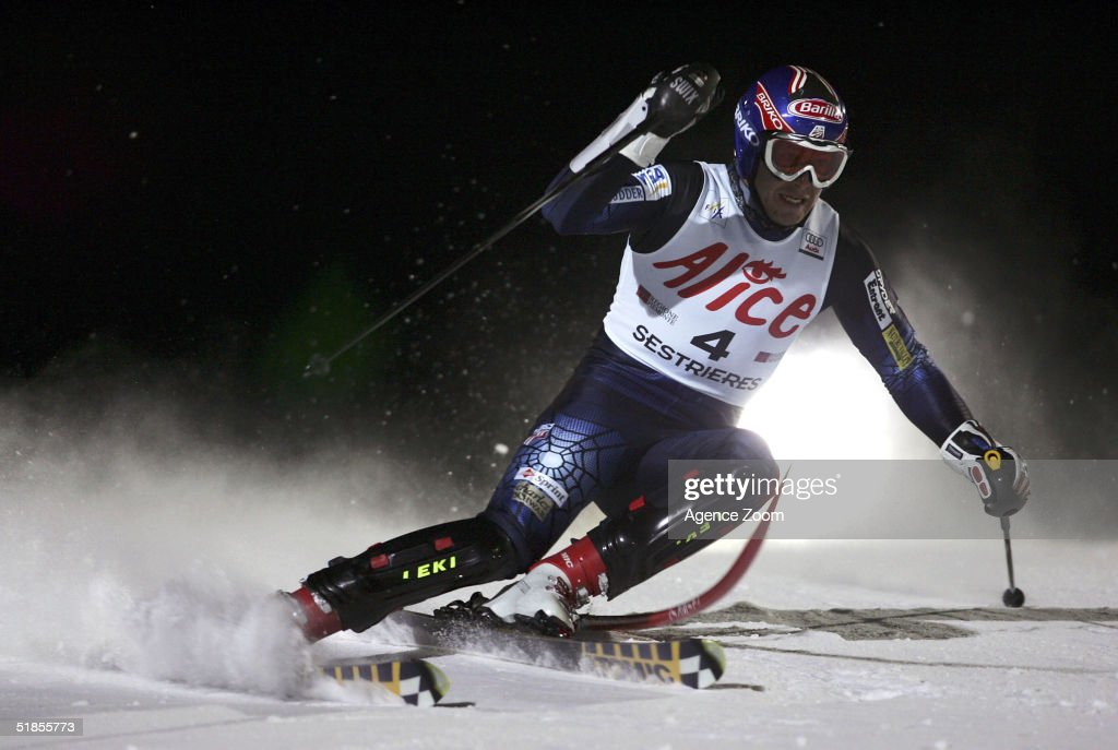 Bode Miller of the USA competes on his way to first place during the FIS Alpine Ski World Cup Men's Slalom Event at Sestriere Sporting Club on December 13, 2004 in Sestriere, Italy.