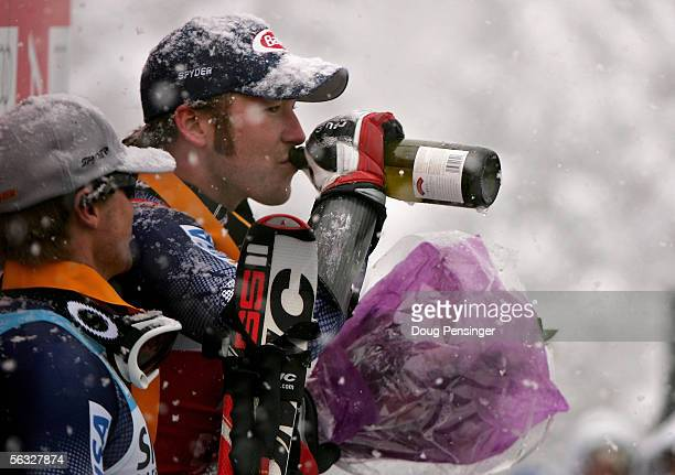 Bode Miller of the USA takes a sip of champagne on the podium after winning the FIS Alpine Skiing World Cup Men's Giant Slalom Race on December 3...