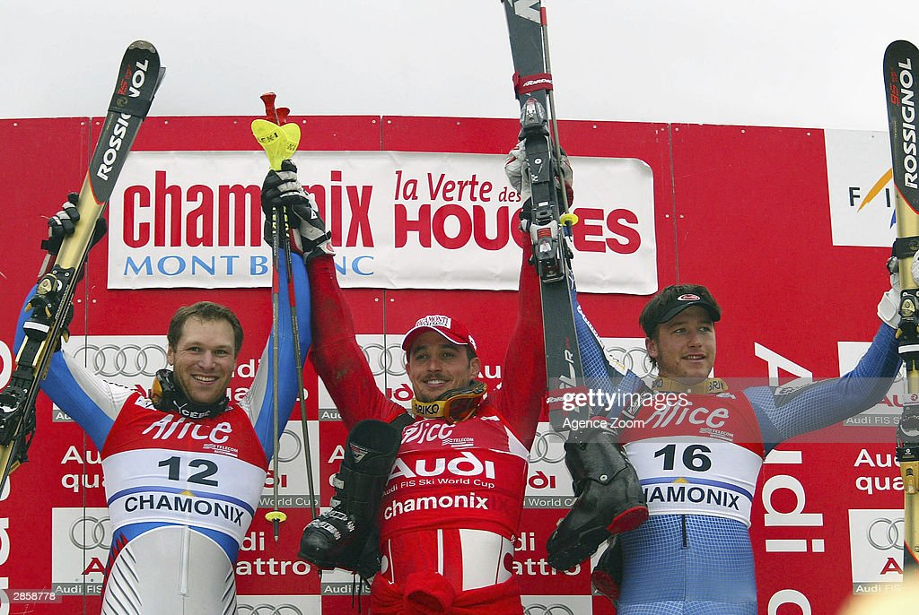 Bode Miller of the USA (R) third place, Pierrick Bourgeat of France (R) second place and Giorgio Rocca of Italy in first place celebrate during the Men's Slalom in the FIS Alpine Ski World Cup 2004 on January 11, 2003 in Chamonix, France.