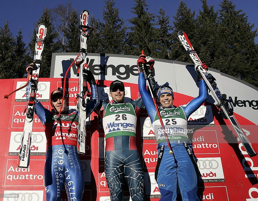 Bode Miller of US (C) celebrates 1st place, Didier Cuche of Switzerland (L) 2nd place and Peter Fill of Italy 3rd place during the FIS Skiing World Cup Men's Downhill on January 13, 2007 in Wengen, Switzerland.