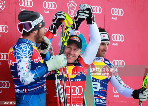 Bode Miller of USA Didier Cuche of Switzerland and Adrien Theaux of France pose on the podium after winning the Hahnenkamm race on January 22 2011 in...