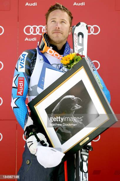 Bode Miller stands on the victory podium for the playing of the National Anthem after the men's downhill on the Birds of Prey at the Audi FIS World...