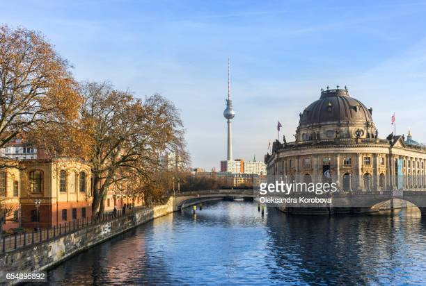 berlin, germany - december 16, 2016. bode museum on museum island with fernsehturm tv tower in background. - istock photos et images de collection