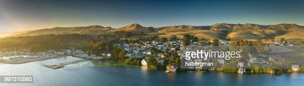 bodega bay houses and marina at dusk - aerial panorama - sonoma county stock pictures, royalty-free photos & images