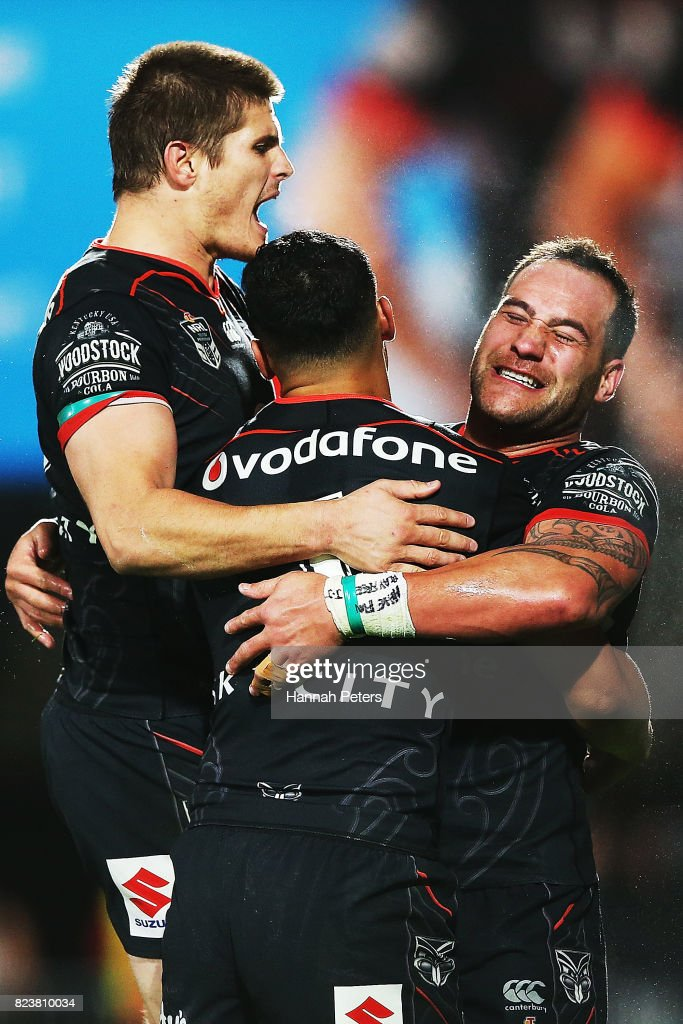 Bodene Thompson celebrates after scoring a try with Blake Ayshford and Roger Tuivasa-Sheck of the Warriors during the round 21 NRL match between the New Zealand Warriors and the Cronulla Sharks at Mt Smart Stadium on July 28, 2017 in Auckland, New Zealand.