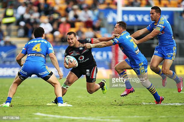 Bodene Thompson of the New Zealand Warriors tries to run between Anthony Watmough and Brad Takairangi of the Parramatta Eels during the round three...