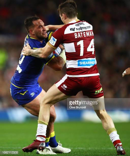 Bodene Thompson of the Warrington Wolves is tackled by John Bateman of the Wigan Warriors during the BetFred Super League Grand Final between...