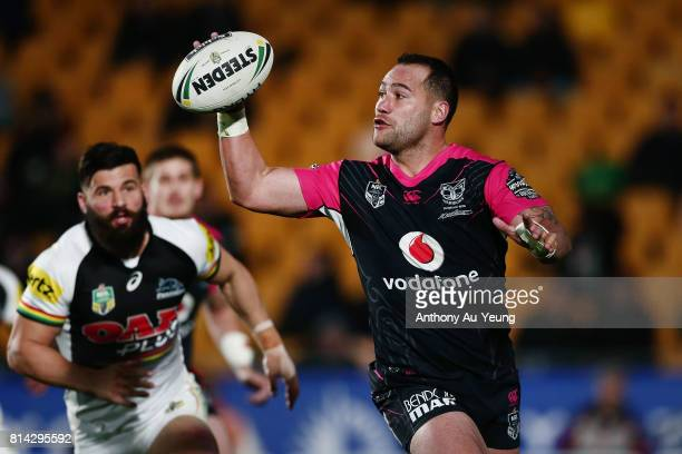 Bodene Thompson of the Warriors controls the ball during the round 19 NRL match between the New Zealand Warriors and the Penrith Panthers at Mt Smart...